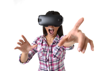 futuristic girl: young attractive happy woman excited using 3d goggles watching 360 virtual reality vision enjoying the fun cyber experience in vr simulation reality and new gaming technology concept