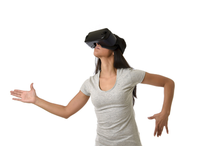 young attractive happy woman excited using 3d goggles watching 360 virtual reality vision enjoying cyber fun experience in vr simulation reality and new gaming technology posing as robot Foto de archivo