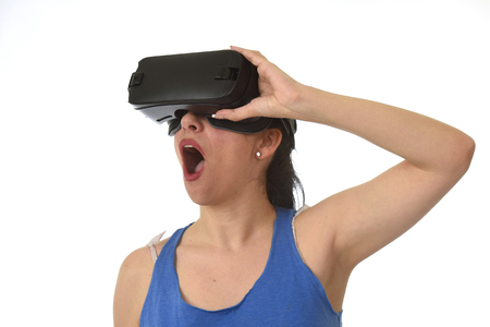 attractive happy woman excited using 3d goggles watching 360 virtual reality vision enjoying cyber fun experience in vr simulation reality and new video gaming technology isolated background