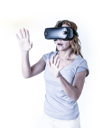 attractive happy and excited woman using 3d goggles watching 360 virtual reality vision enjoying cyber fun experience in vr simulation reality and new video gaming technology isolated background