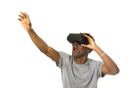 young happy and excited afro american man wearing virtual reality vr 360 vision goggles enjoying video game isolated on white background in innovation and gaming technology concept