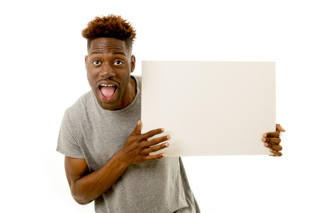 young attractive black afro american man smiling happy and showing a blank billboard with copy space for adding advertising text isolated on white background