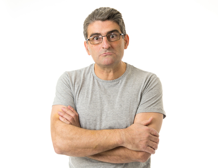 portrait of 40s weird and nerd man on glasses in ridiculous silly and stupid face expression  looking at camera isolated on white background in freak and idiot concept Stock Photo