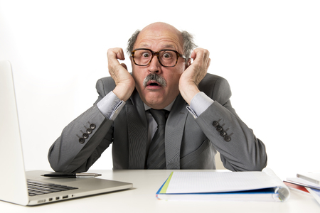 senior mature business man with bald head on his 60s working stressed and frustrated
