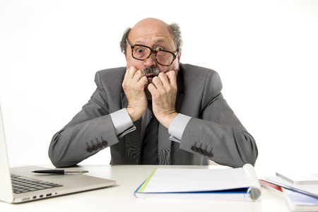 senior mature business man with bald head on his 60s working stressed and frustrated at office computer laptop desk looking desperate and overwhelmed in job mistake and problem concept Stock Photo