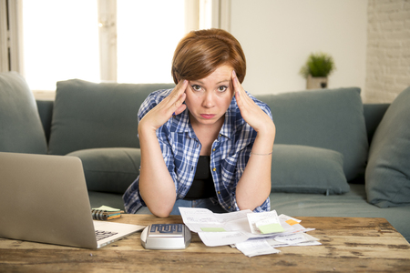 young sad worried and desperate woman banking and accounting home monthly and credit card expenses with computer laptop