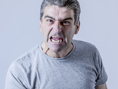 portrait of 40s to 50s white angry and upset guy and crazy furious and aggressive face expression nagging and complaining isolated on grey background Stock Photo - 93016064