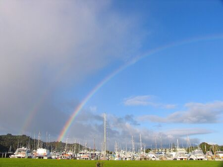 Rainbow And Harbor In New Zealand photo