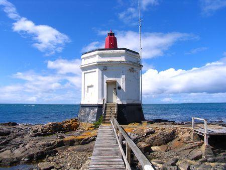 Lighthouse At Beach Stock Photo - 3589088