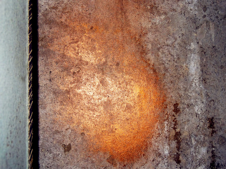 Copper and gold paint stains on old grunge wall