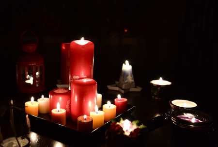Burning candles in the dark 写真素材