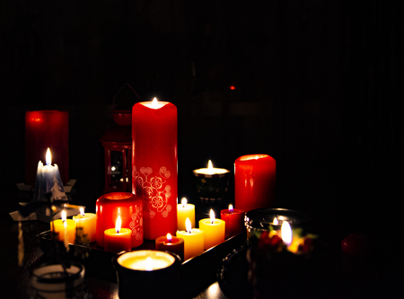 Several burning candles in the dark