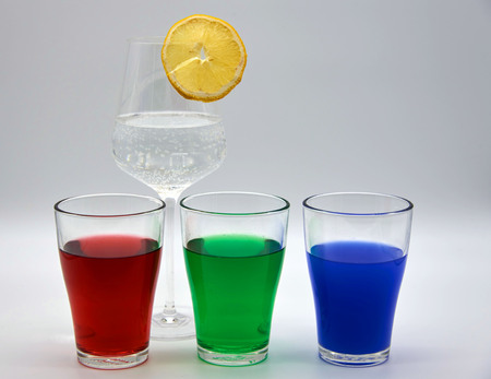 Glasses with colored water. RGB red blue green