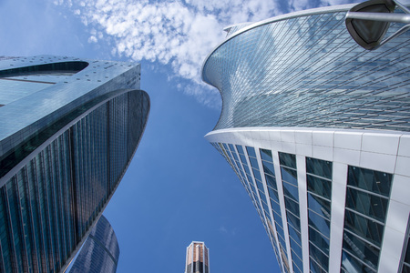 May 2019, Russia, Moscow.Bottom view of the business center Moscow city. Blue sky Imagens