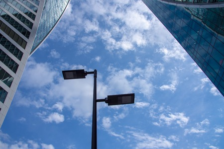 The silhouette of a lantern against the blue sky and clouds. Imagens