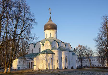 Russia, Alexandrovskaya Sloboda,Trinity Cathedral, November 2019.Elegant white Church on a snow-dusted glade against the blue sky.