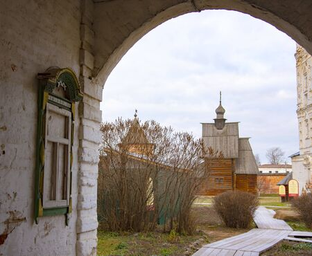 Russia, Yuriev-Polsky, November 2019. View through the arch to the old wooden Church. Editorial