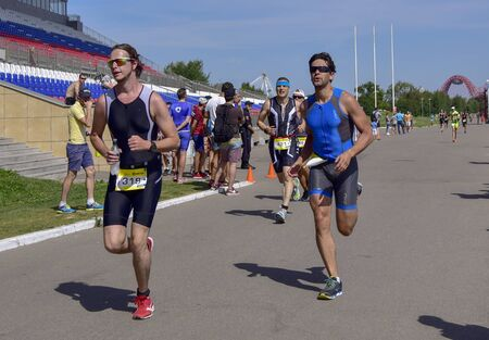 Russia, Moscow, August 2018. Men of different ages run a marathon. Clear Sunny summer day.