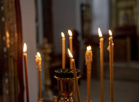 Burning in the dim light of candles in the Christian Church. Banco de Imagens