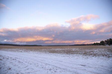 gentle sunset over a snow-covered field. Winter landscape. Banco de Imagens