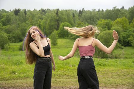 Two teenage girls find out their relationship on a walk.