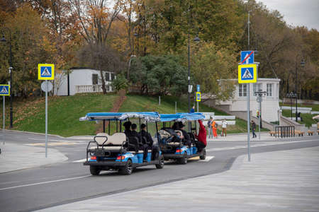 Russia, Moscow, October 2020. Photo shoot of police officers driving an electric car along the embankment of the Northern river station. Editoriali