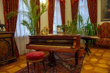 Large old wooden Grand piano and vintage furniture in the hall of the Pushkin Museum.
