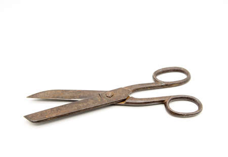 Old metal tailor scissors on a white background.