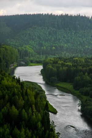 Bend of the mountain river in woodland in Siberia
