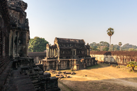 Angkor Wat inside temple in the morning. Siem Reap, Cambodia. Angkor Wat is one of the largest religious monument and a famous tourist attraction in the world.