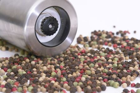 Stainless pepper mill with pepper corns.