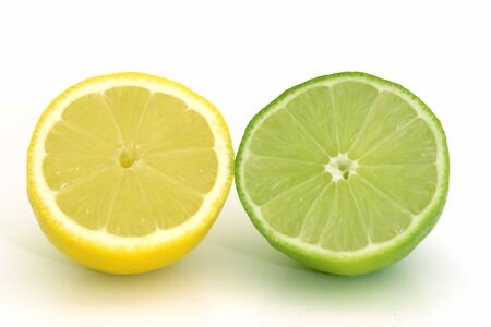 citric: Isolated lemon and lime halves Stock Photo