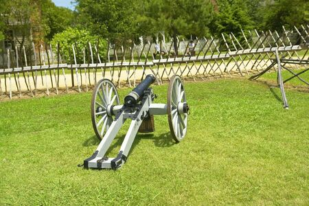 Civil War Cannon Behind Wooden Spiked Baracade                               photo