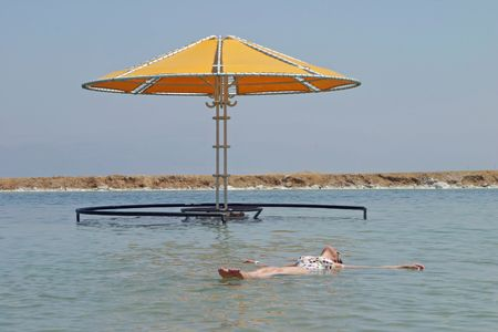 Floating at the Dead Sea, Israel Stock Photo