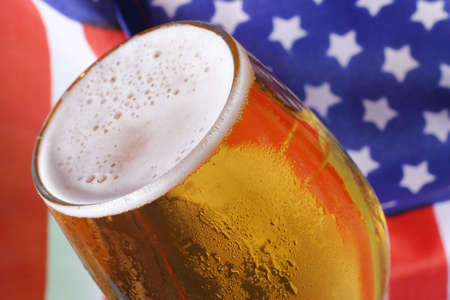hour glasses: Cold beer macro and the American flag. Stock Photo