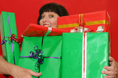Smiling woman, holding gifts.