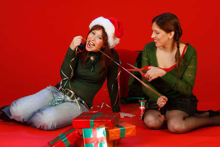 Two young women, getting ready for Christmas Stock Photo - 912418