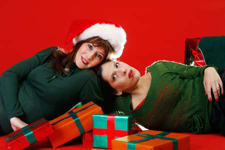 Two young women, getting ready for Christmas Stock Photo - 912421