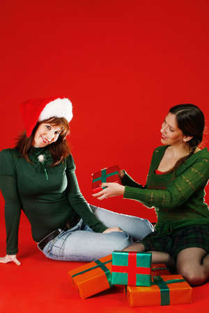 Two young women, getting ready for Christmas