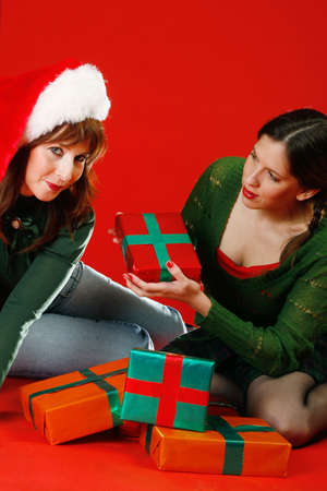Two young women, getting ready for Christmas Stock Photo - 912423