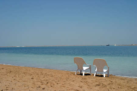 Two chairs by the Dead Sea Stock Photo