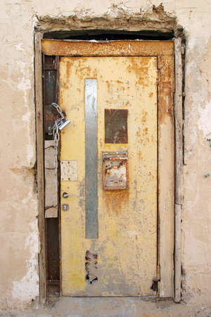 Old locked door, very old, very rusty Stock Photo