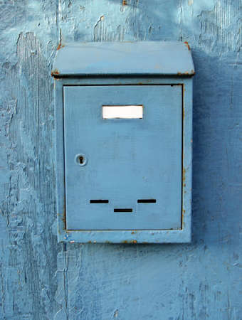 Old blue mailbox, blank name tag.