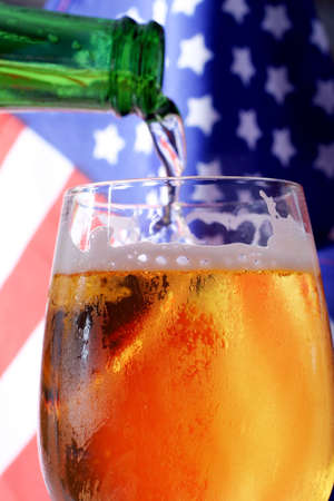 Cold beer macro and the American flag. Stock Photo