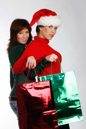 Two girls on a Christmas shopping spree Stock Photo - 915666