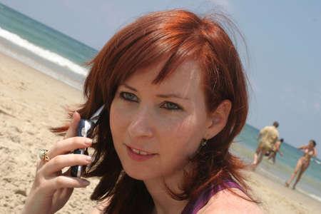 Talking on the phone, at thr beach. Stock Photo - 915667
