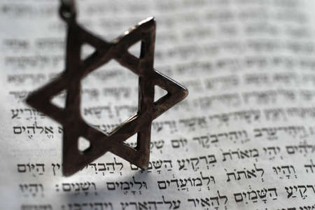 Star of David over the first page of the old testament in Hebrew.  Stock Photo