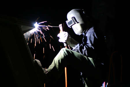A welder, working at night. Stock Photo