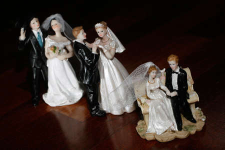 Three couples - bride and groom dolls