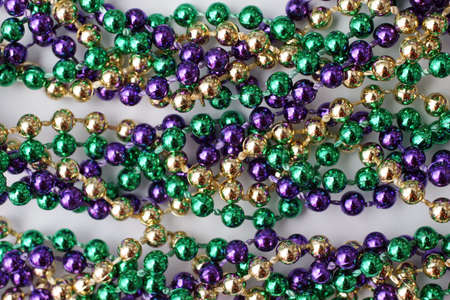 Mardi Gras beads - green, gold, purple Stock Photo - 915485